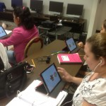 HFC Level 3/ 4 students working with IPads . Photo by M . Yanez
